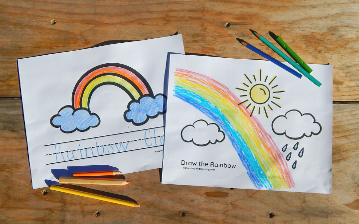 two rainbow coloring pages on a wooden table colored in using colored pencils