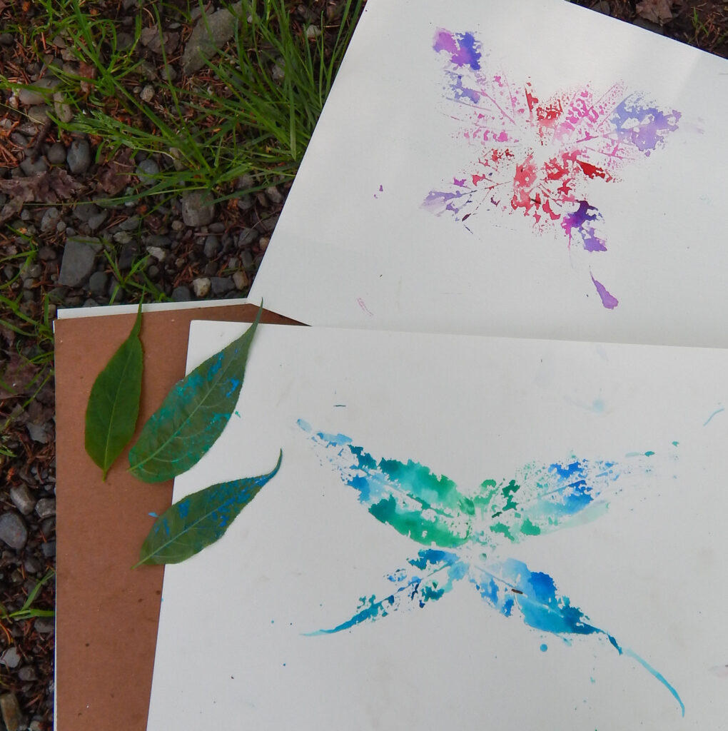 stamped butterfly summer craft with leaves and paint