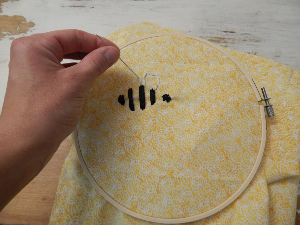 hand threading white embroidery floss for bee's wings