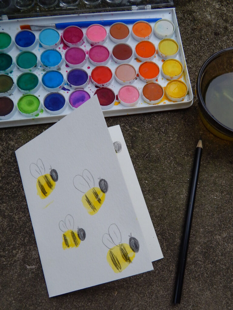 handmade card bumble bee craft with watercolor paint and colored pencils