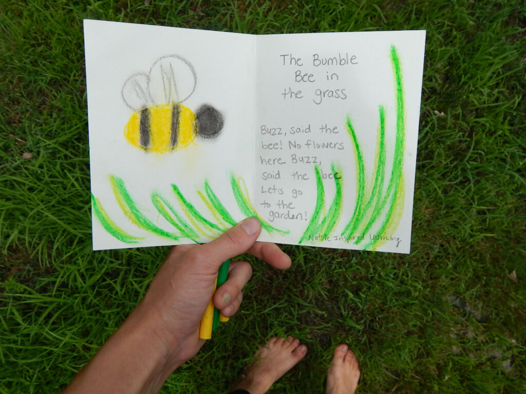 hand holding a bee poem written in a nature journal barefeet on the ground outside below entry