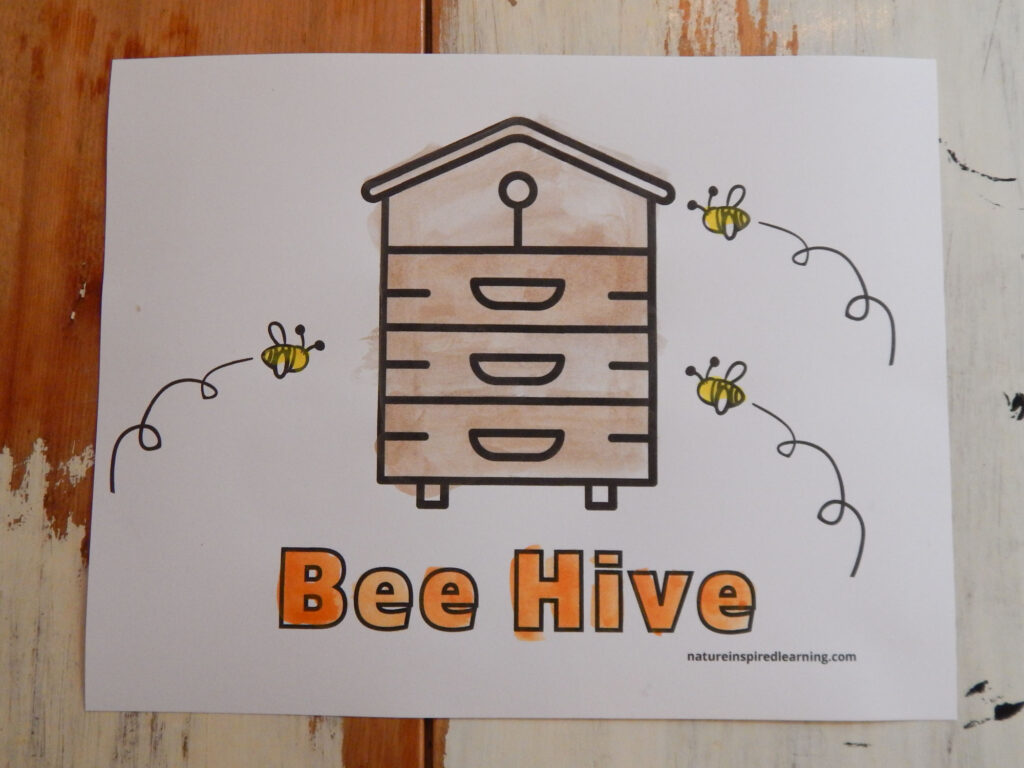 bee hive coloring sheet printed off and painted three small honey bees with the word bee hive