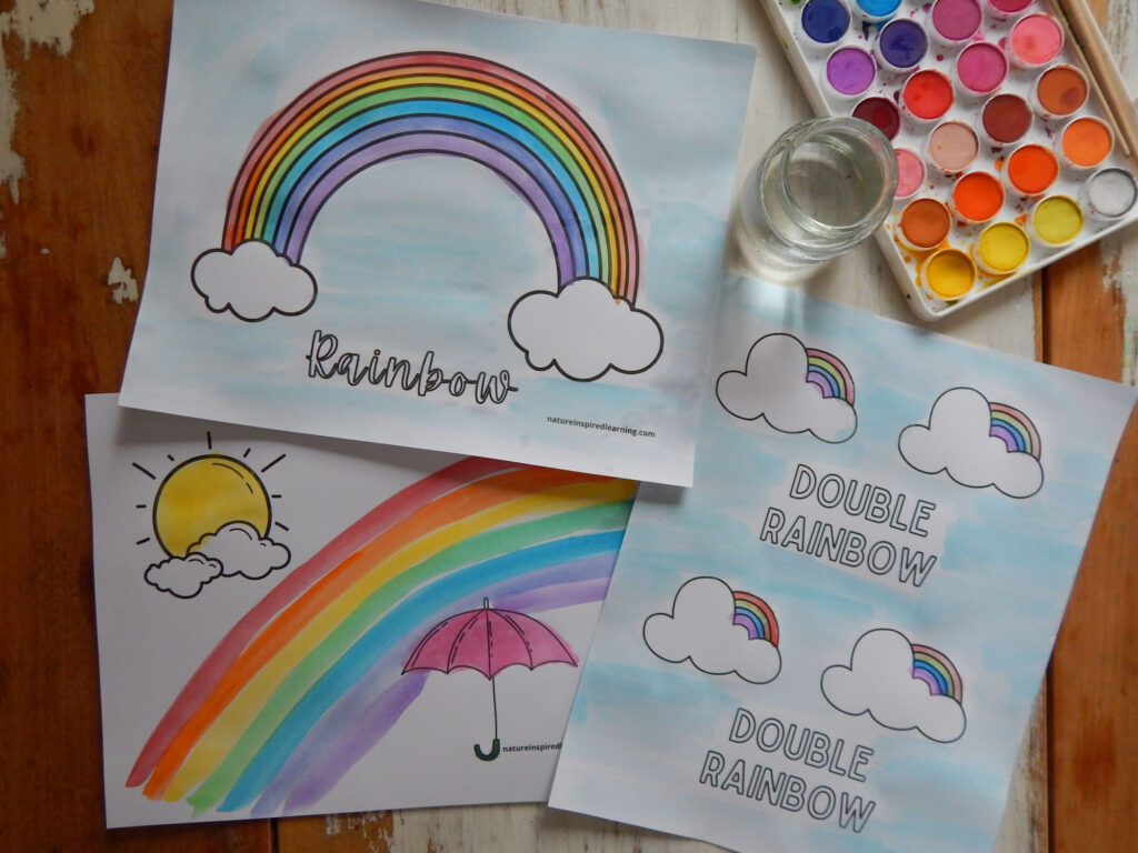 three free printable rainbow coloring pages printed of an placed on a wooden table colored in using watercolor paints in bright rainbow colors roy g biv with glass of water