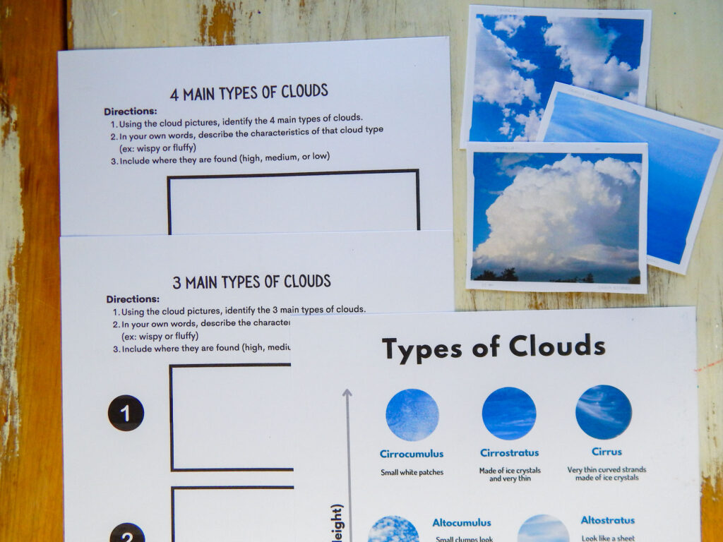 four main types of clouds worksheet under three main types of clouds worksheet types of clouds printable and three cloud cards overlapping on a wooden table